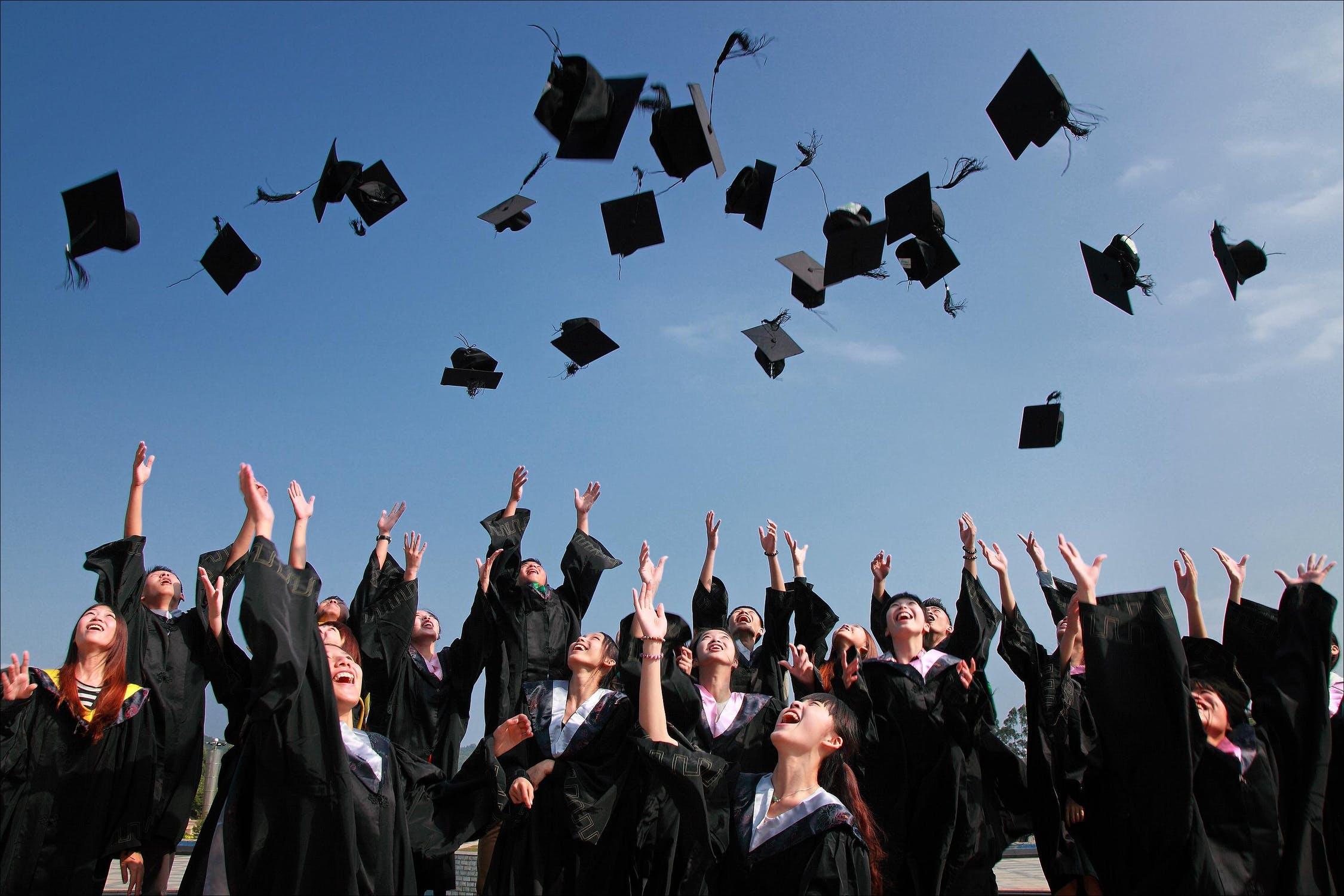 image of a graduation cap toss