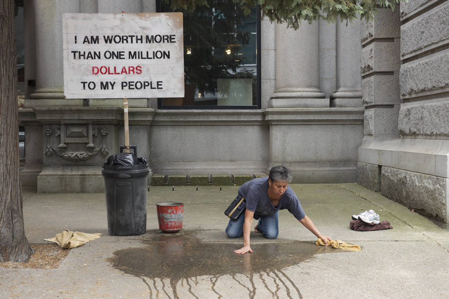 """sign reading """"I am worth more than one million dollars to my people"""""""