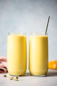 two glasses of mango lassi